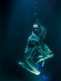 Woman diving under the water