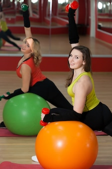 Woman doing sport with inflatable balls