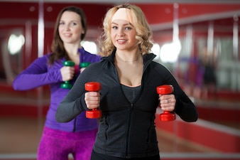 Woman doing sport with red weights