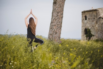 Woman doing yoga at abandoned building