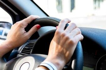 Woman driving car through the city