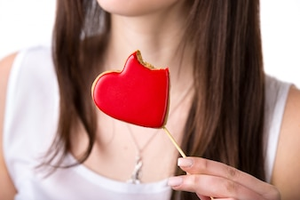 Woman eating a heart