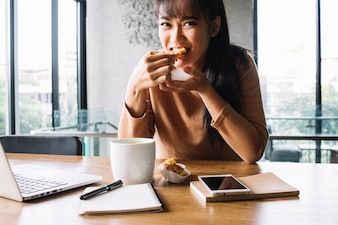 Woman eating at desk