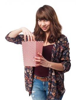 Woman eating popcorn from a packet of popcornwoman eating popcorn from a packet of popcorn