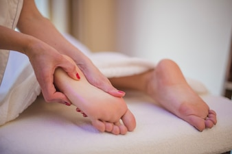 Woman getting massage of feet