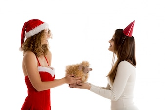 Woman giving a gift to another