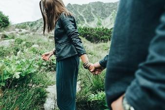 Woman grabbing her boyfriend's hand
