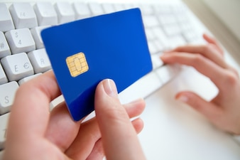 Woman hands, laptop, credit card, shopping online payment