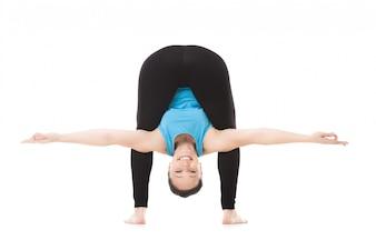 Woman hanging body between her legs