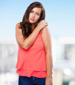 Woman having a shoulder ache