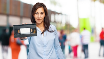 Woman holding a vhs tape