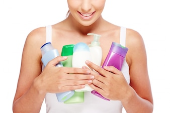 Woman holding different lotions