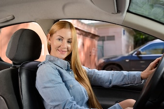 Woman in car with massage seat cushion