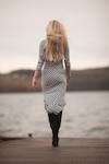 Woman in dress walking on pier