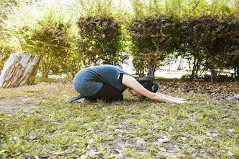 Woman in half tortoise position