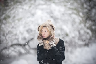 Woman in warm clothes looking away