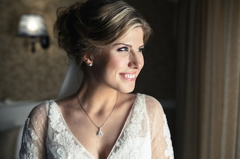 Woman in wedding dress smiling
