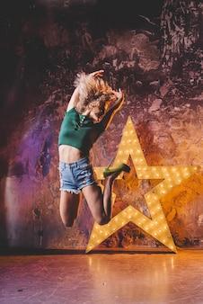 Woman jumping and dancing at star