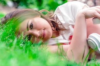 Woman laying on grass close up