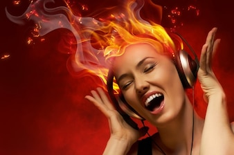 Woman listening to music with burning hair