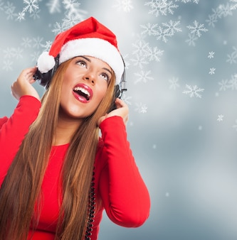Woman listening to music with christmas background