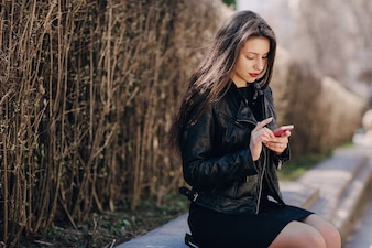 Woman looking a smartphone