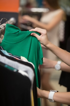 Woman looking at a green shirt