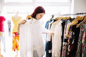Woman looking at blouse