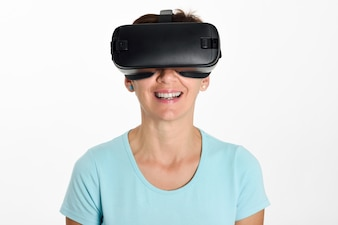Woman looking in VR glasses and gesturing with his hands.