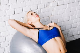 Woman lying on fitball