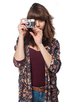 Woman making a photo with an antique camera