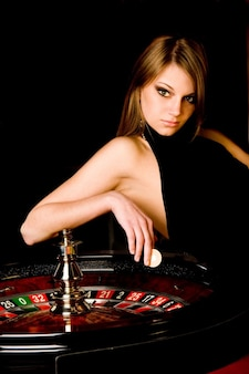 Woman modeling next to a casino roulette