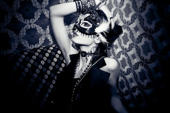 Woman modeling with carnival mask