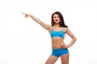 Woman pointing and the other arm on her hip