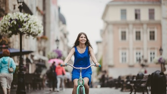 Woman riding a bike in a city