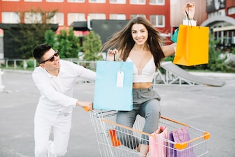 Woman riding shopping cart