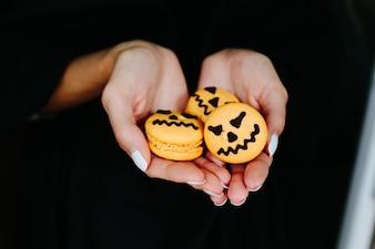 Woman's hands with pumpkin biscuits