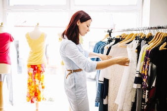 Woman searching for new clothes