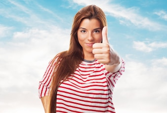 Woman showing a thumb up