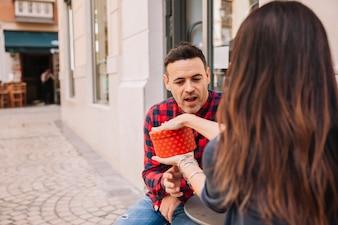Woman showing gift box to boyfriend