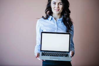 Woman showing laptop
