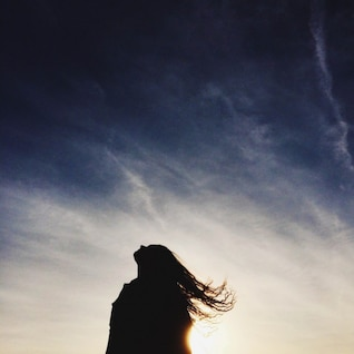 Woman silhouette against the sky