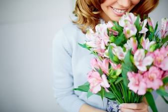 Woman smelling a bouquet