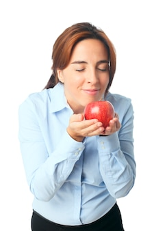 Woman smelling an apple