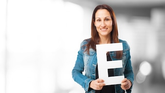 Woman smiling holding the letter  e