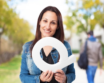 Woman smiling holding the letter  q