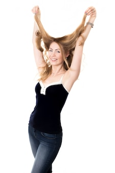 Woman smiling while straightening her hair