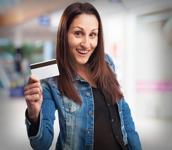 Woman smiling with a credit card