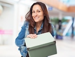 Woman smiling with a green box