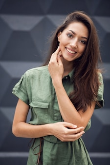 Woman smiling with a hand on her face
